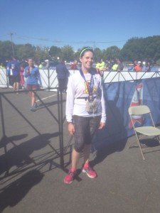 This is what happens when you ask a preoccupied stranger to get a pic of you with the finish line in the background. Note lack of finish line. She did take three versions, so I guess that was nice.