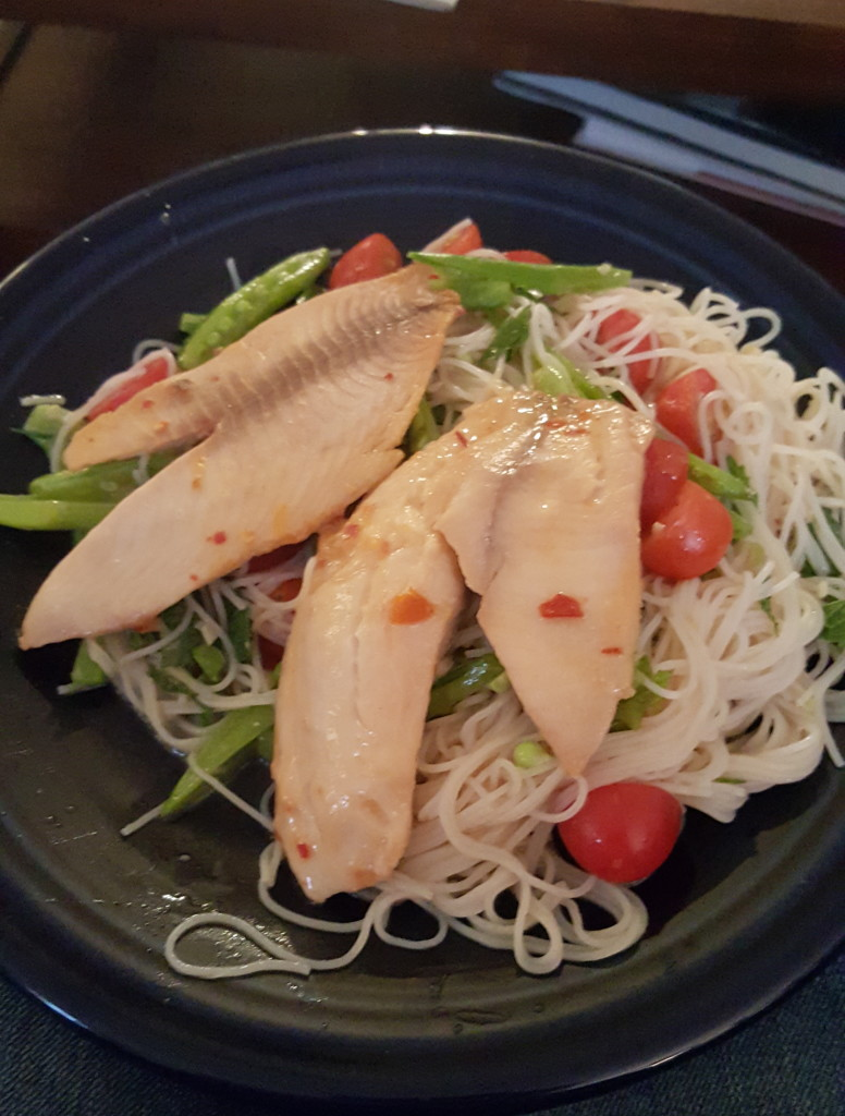 Tilapia with rice noodle salad and veggies.