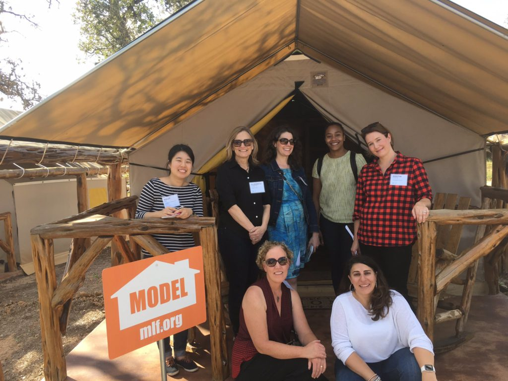 The ILN Innovation Safari group outside the covered canvas tent home.